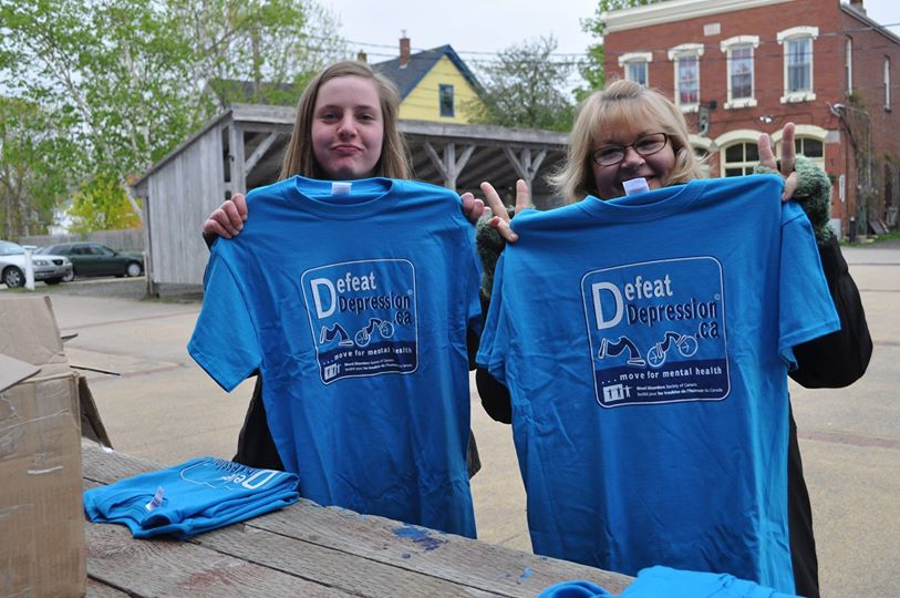 Annapolis County Volunteers presenting Defeat Depression T-Shirts
