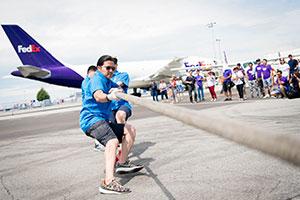 Team pulling a plane