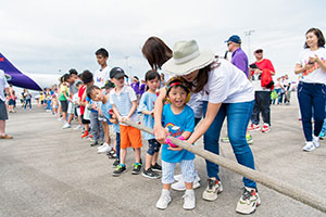 Kids pulling a plane