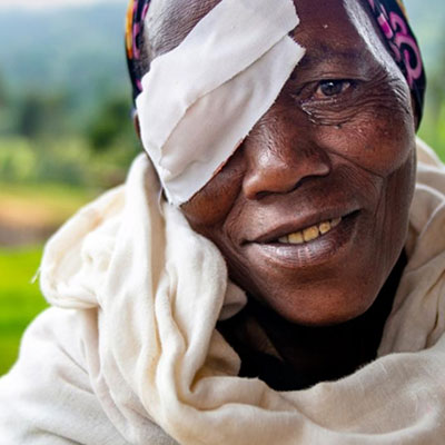 Elderly woman with eye patch