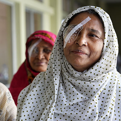 Two older women with eye covers after surgery