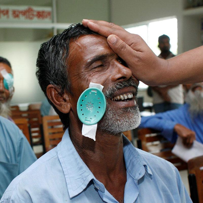 Older gentleman getting eye exam