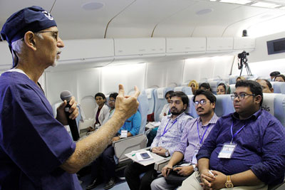Volunteer instruction a class on the Flying Eye Hospital