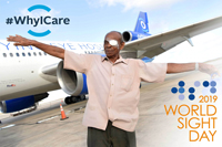 Elderly man outside Orbis plane after surgery - World Sight Day